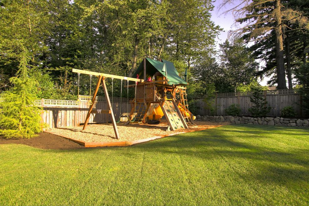 Outside Playsets with Traditional Landscape Also Backyard Grass Lattice Lawn Mulch Planters Rock Wall Stone Wall Swing Sets Turf Wood Fencing