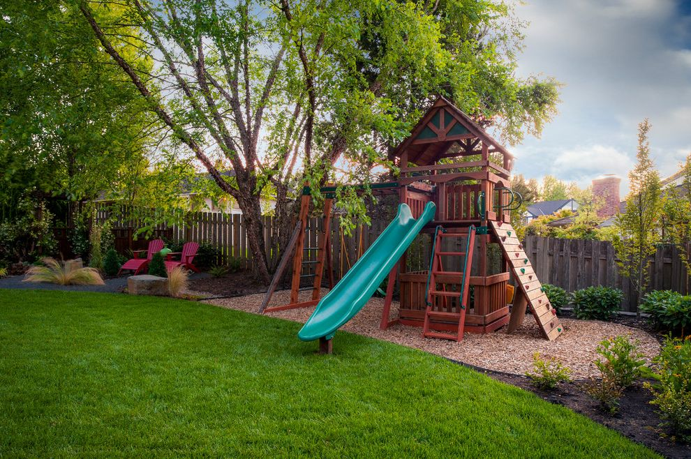 Outside Playsets with Traditional Landscape  and Adirondack Chairs Backyard Garden Grass Landscape Lawn Plants Playground Slide Treehouse Wood Fence