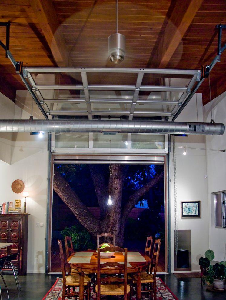 Pella Garage Doors   Industrial Dining Room Also Ceiling Fan Concrete Floor Exposed Duct Garage Door Glass Garage Door Industrial Interior Garage Door Modern Ceiling Fan Oval Dining Table Wood Ceiling