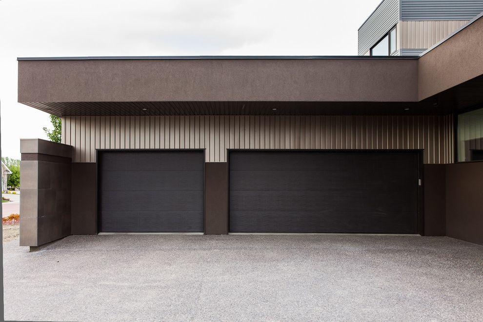 Pella Garage Doors with Modern Garage Also Driveway Earth Tone Colors Flat Roof Garage Door Garage Doors Geometric Geometry Minimal Outdoor Lighting Roof Line Soffit
