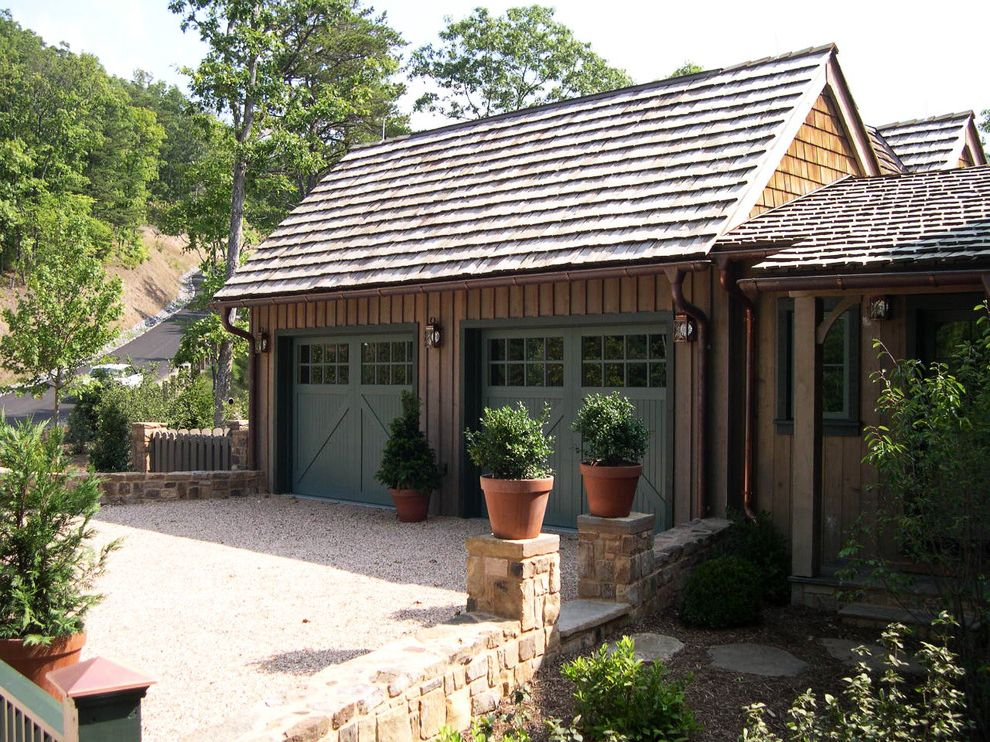 Pella Garage Doors with Traditional Garage  and Board and Baton Siding Carriage Doors Courtyard Drive Garage Gravel Green Landscape Architecture Landscape Design Lanterns Planting Planting Design Potted Plants Shingle Roof Stone Wall Wall