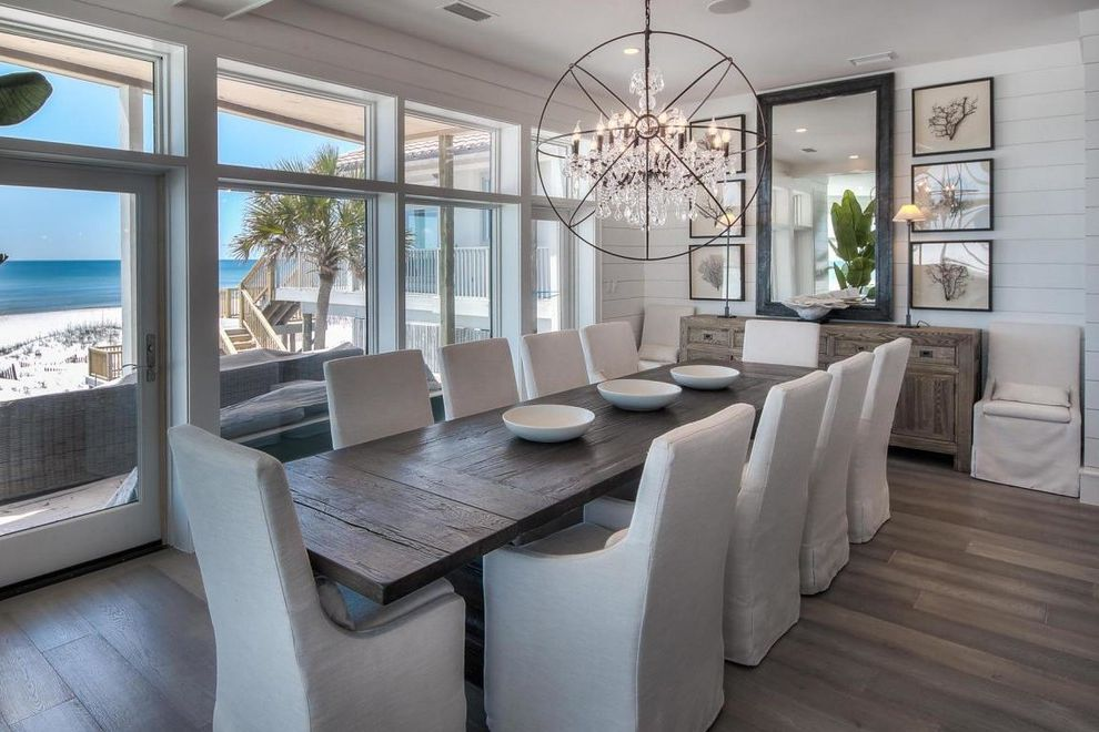 Restoration Hardware Seattle with Beach Style Dining Room  and Beach Front Beach View Chandelier Console Table Coral Wall Art Distressed Dining Table Large Windows Long Dining Table Mirror Natural Light Shiplap