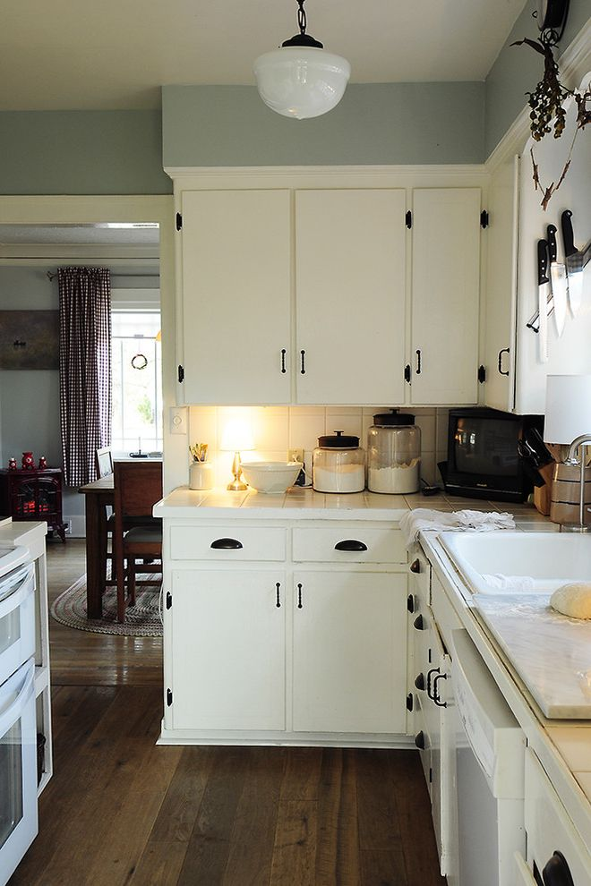 Restoration Hardware Seattle with Traditional Kitchen  and Glass Canister Kitchen Hardware Pendant Lighting Schoolhouse Pendant Under Cabinet Lighting White Kitchen Wood Flooring