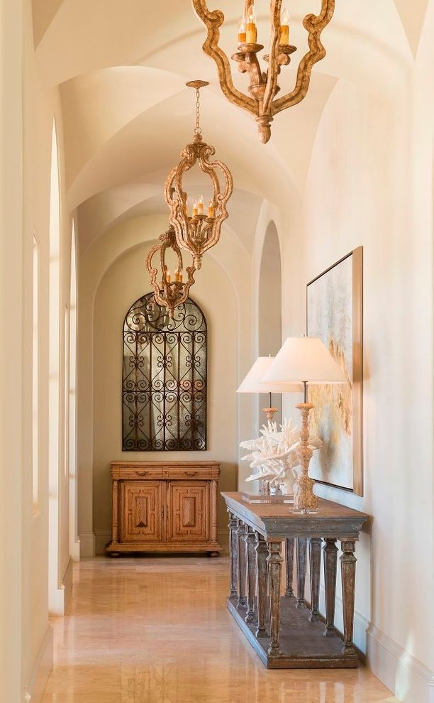 Sherwin Williams Tucson   Mediterranean Hall  and Arched Doorways Decorative Mirror Groin Ceiling Mediterranean Style Symmetry Table Lamp Vintage Furniture Wood Buffet Table Wood Console