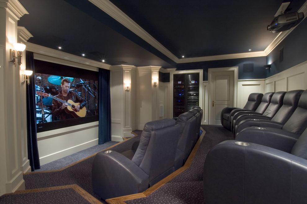 Short Pump Theater with Traditional Home Theater  and Blue Curtains Blue Leather Blue Walls Crown Molding Cup Holders Home Theater Movie Theater Raised Panel Doors Recessed Lighting Recessed Pane Millwork Tiered Seating Wall Sconces White Painted Wood
