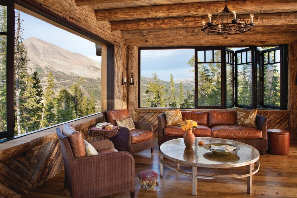 Sliding Window Air Conditioner   Rustic Family Room Also Accent Table Cabin Folding Windows Hardwood Floor Iron Chandelier Logs Mountain View Picture Window Rough Hewn Wood Round Coffee Table Side Table Sitting Area Stool Weathered Wood Wicker Chairs