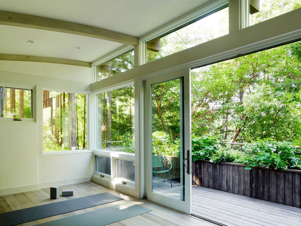 Sliding Window Air Conditioner with Contemporary Home Gym  and Arched Ceiling Forest View Sliders Transom Windows White Wood Beams Wood Deck