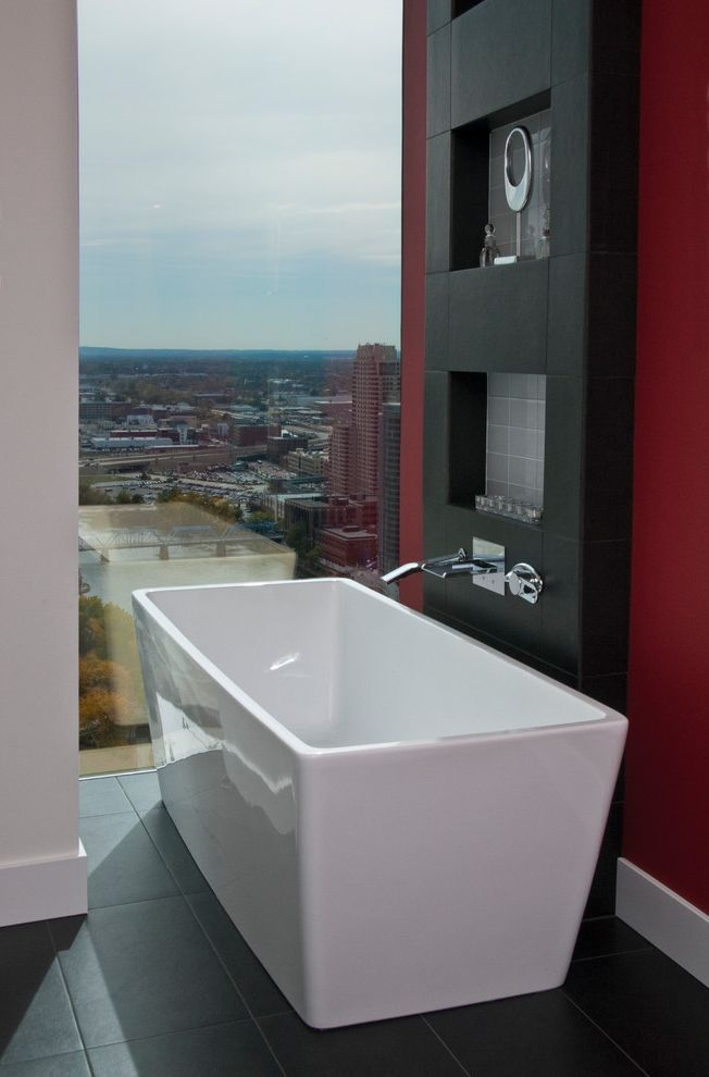 State Theater Traverse City   Contemporary Bathroom  and Dark Tile Freestanding Tub Large Window Panorama Window Red Wall Stainless Steel Tiled Floor Tub Wall Mounted Faucet