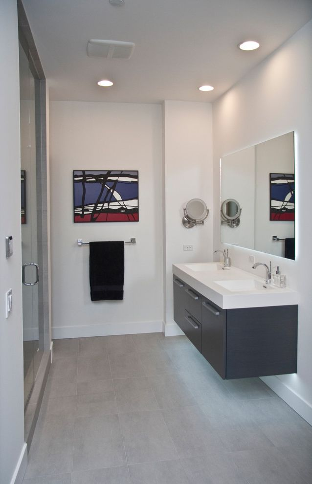 State Theater Traverse City with Contemporary Bathroom  and Art Floating Vanity Glass Shower Door Grey Vanity Mirror Shower Tiled Floor Vanity