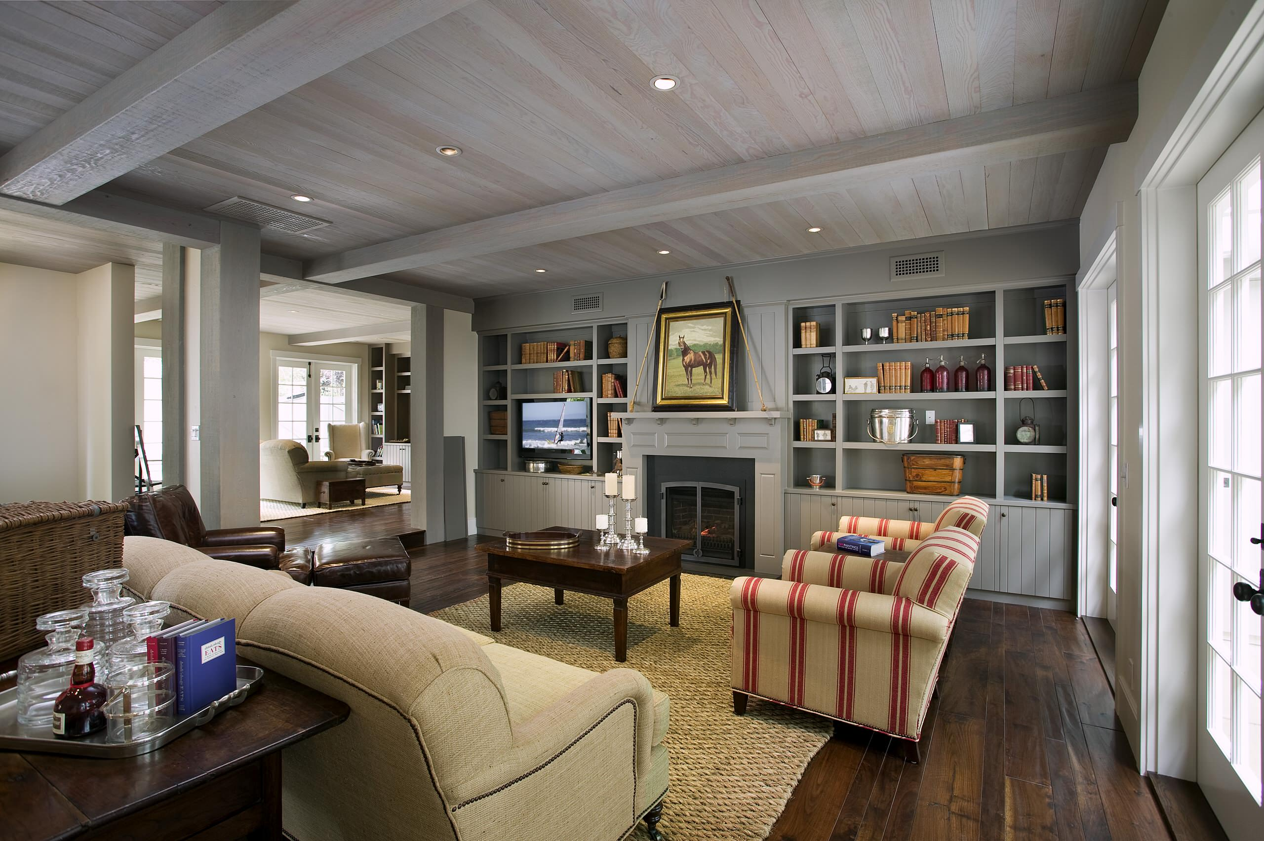 Armchairs and Accent Chairs Farmhouse Living Room Built in Bookshelf Rustic Wood Floor Whitewashed Ceiling