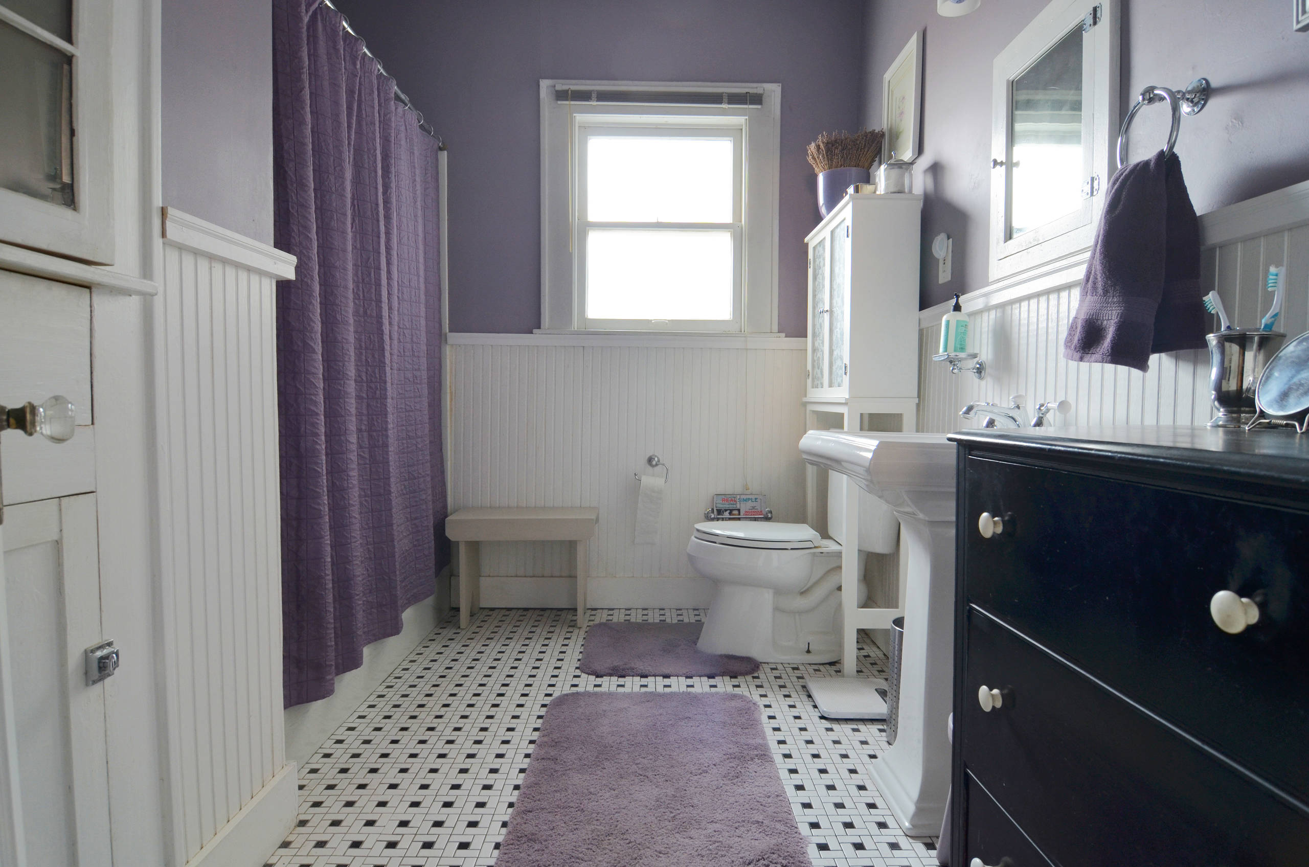 Colors that go with lavender Traditional Bathroom wainscotting black and white tile