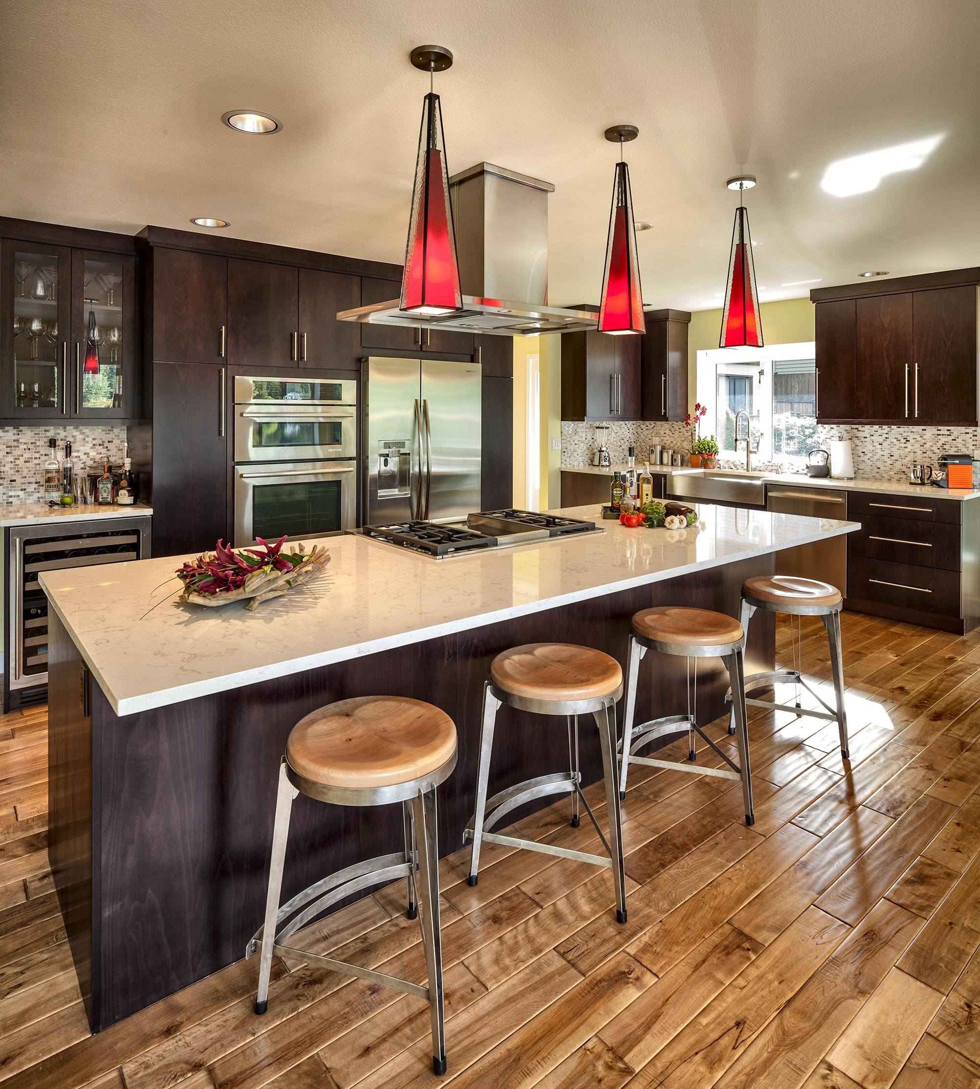 Dark cabinets light countertops Contemporary Kitchen beige mosaic tile backsplash industrial bar stool wood floor