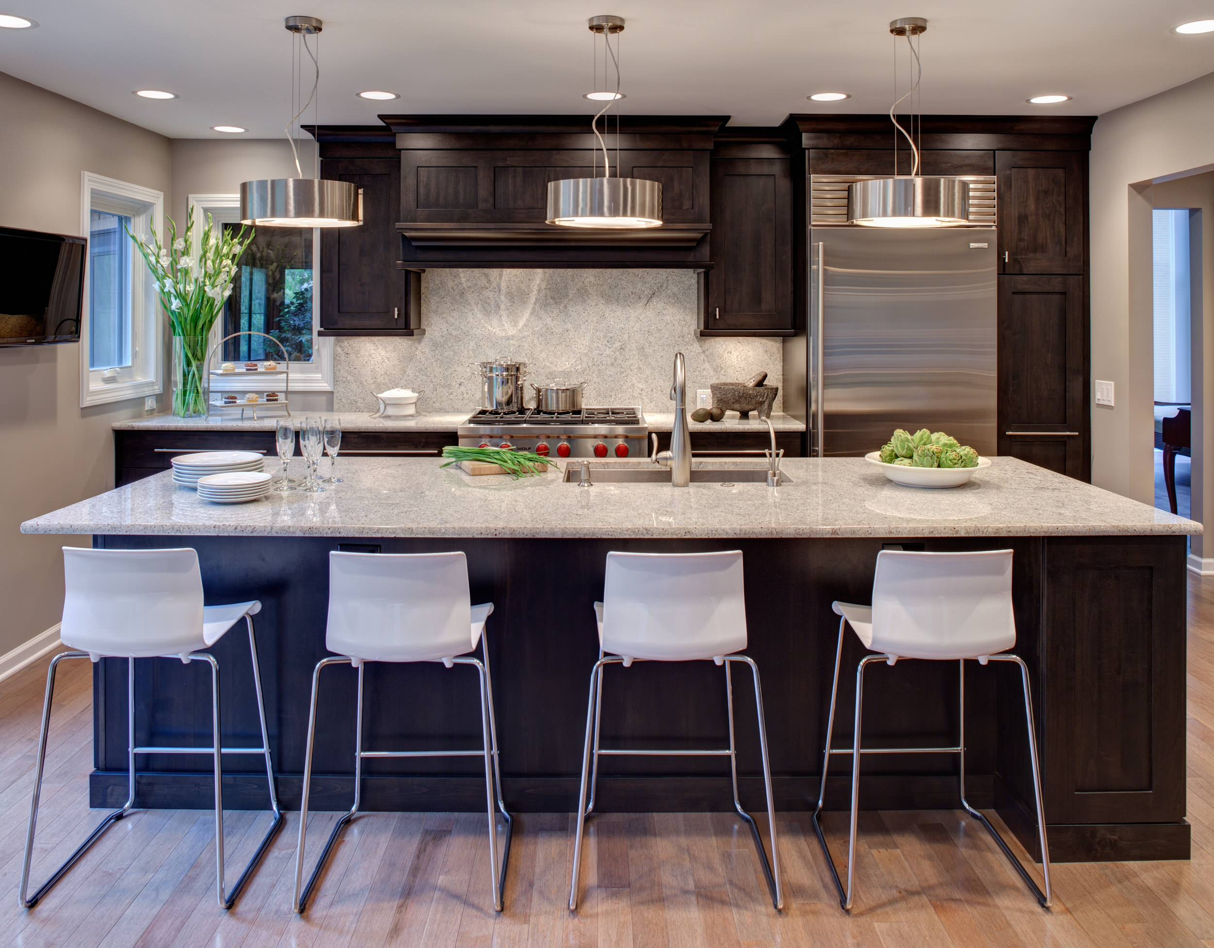 Dark Cabinets Light Countertops Contemporary Kitchen Full Height Granite Back Splash Island Seating Silver Pendant Lights