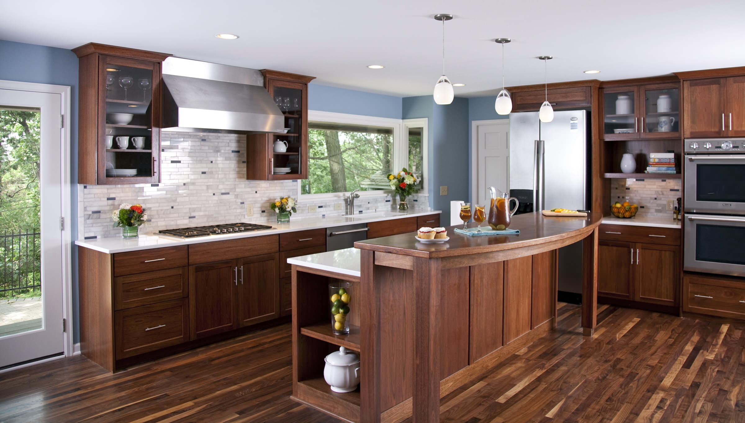 Gray countertops with white cabinets Transitional Kitchen dark wood floors glass door cabinets pietra cardosa limestone