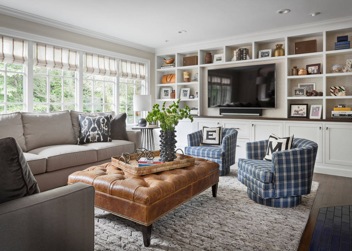 Armchairs and accent chairs Transitional Family Room swivel chairs and tufted ottoman