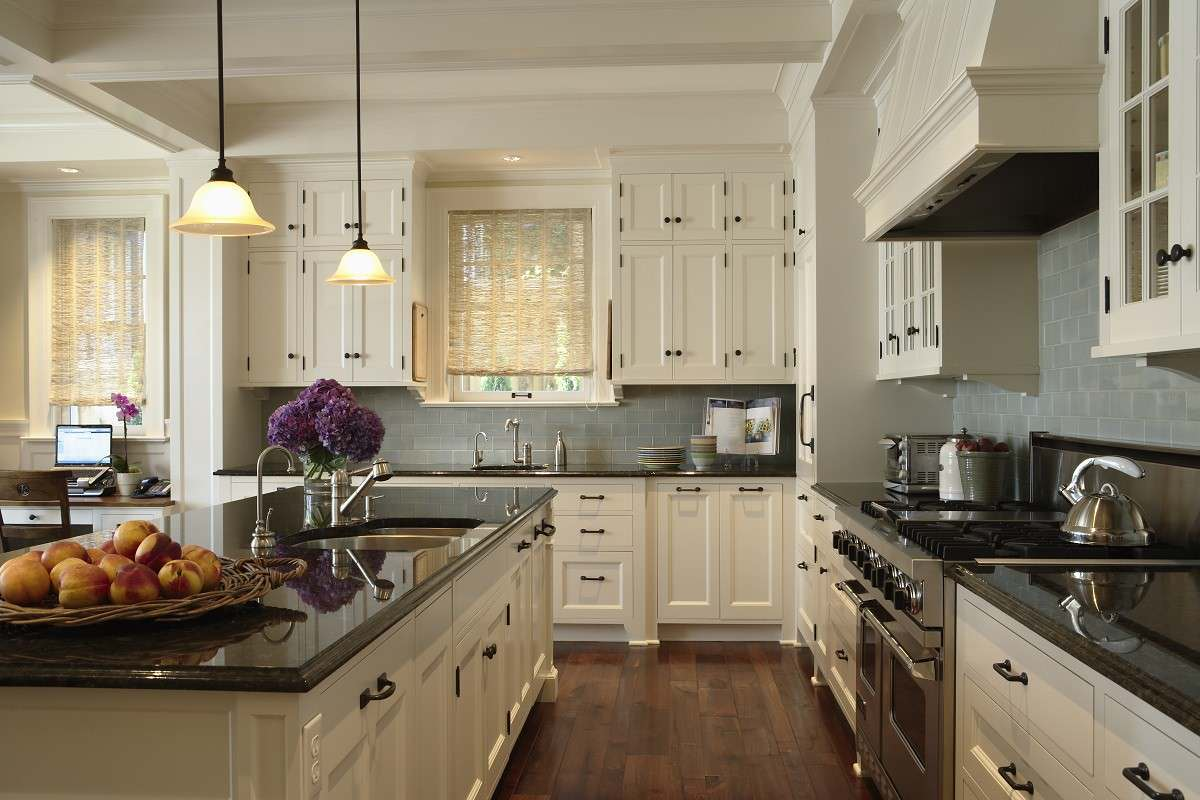 Cabinet knobs and handles Traditional Kitchen glass subway tile white cabinets black knobs