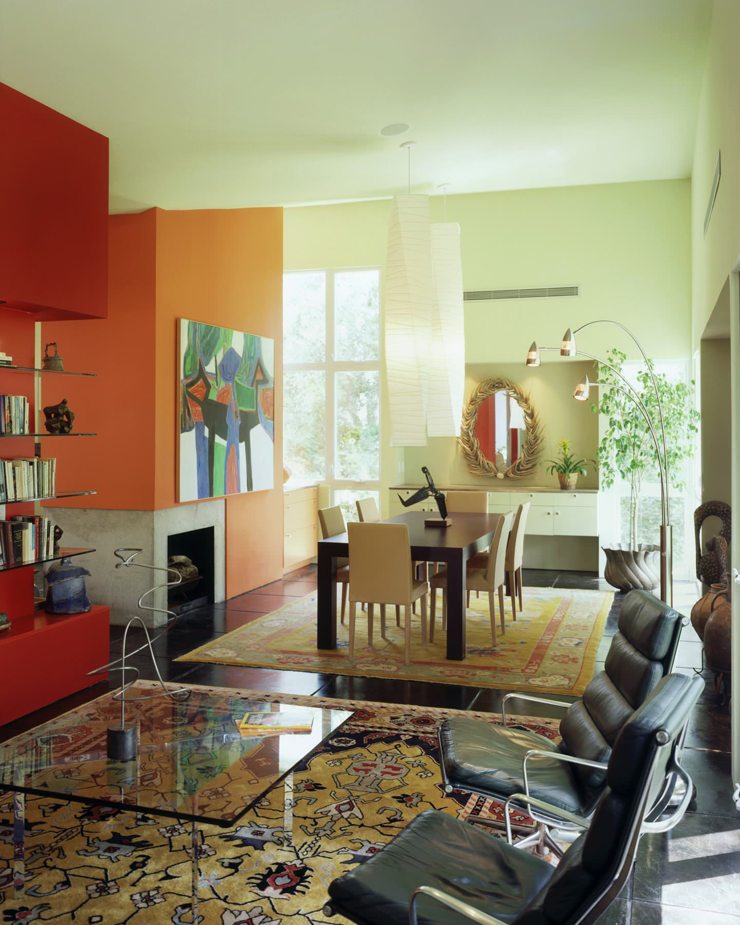 Colors that go with orange Contemporary Dining Room accent wall dark floor