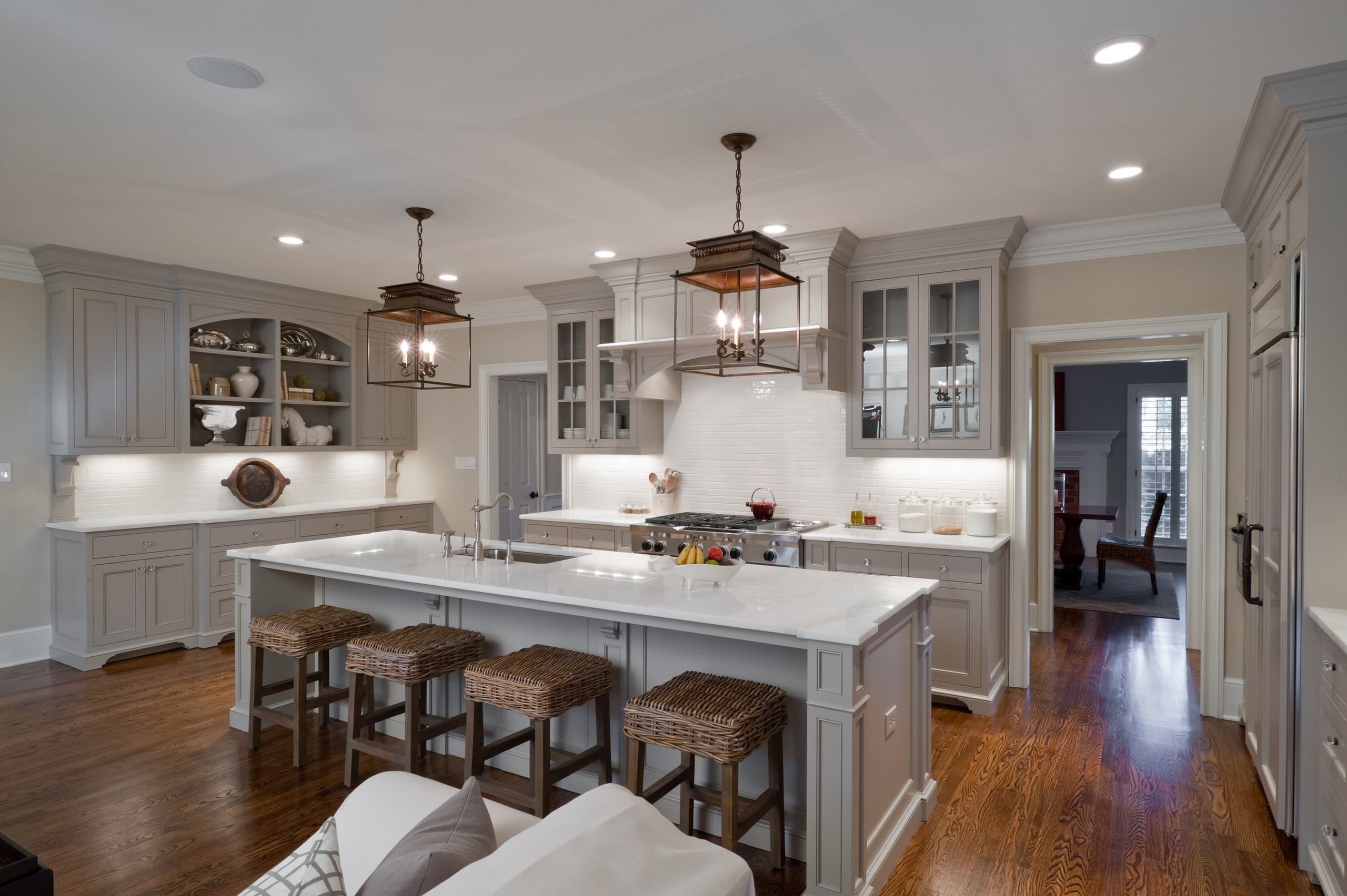 General contractors charlotte nc Traditional Kitchen glass front cabinets pendant lanterns woven counter stools