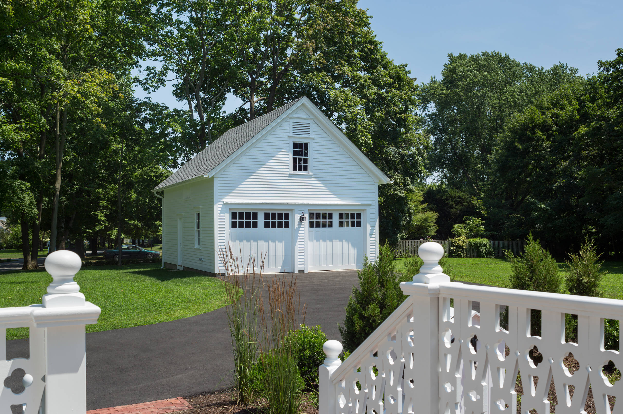 Two car garage size Farmhouse Garage white garage doors white siding gable roof