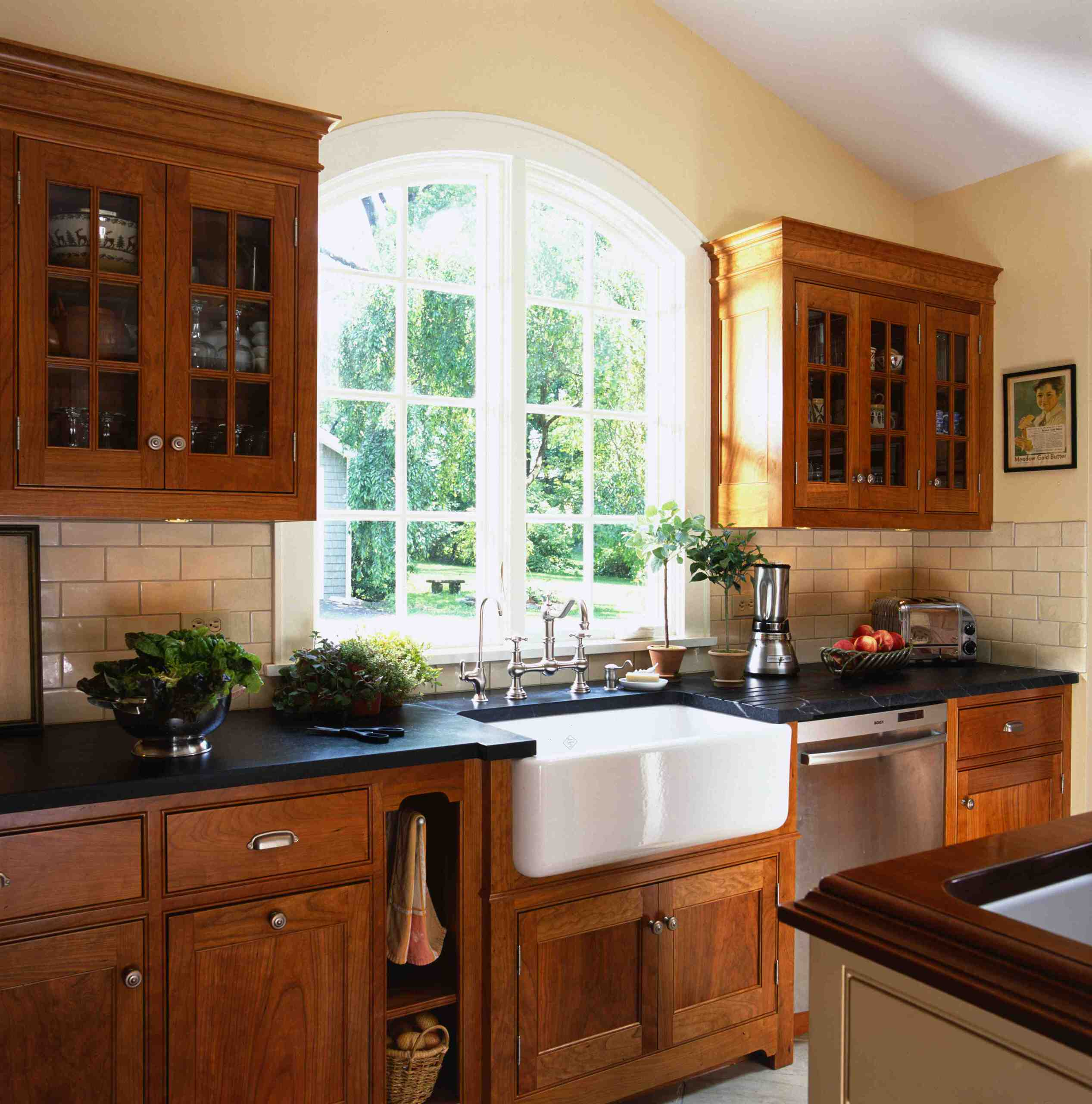 Kitchen and utility sinks Victorian Kitchen cherry cabinets black countertop Wood Kitchen Cabinets