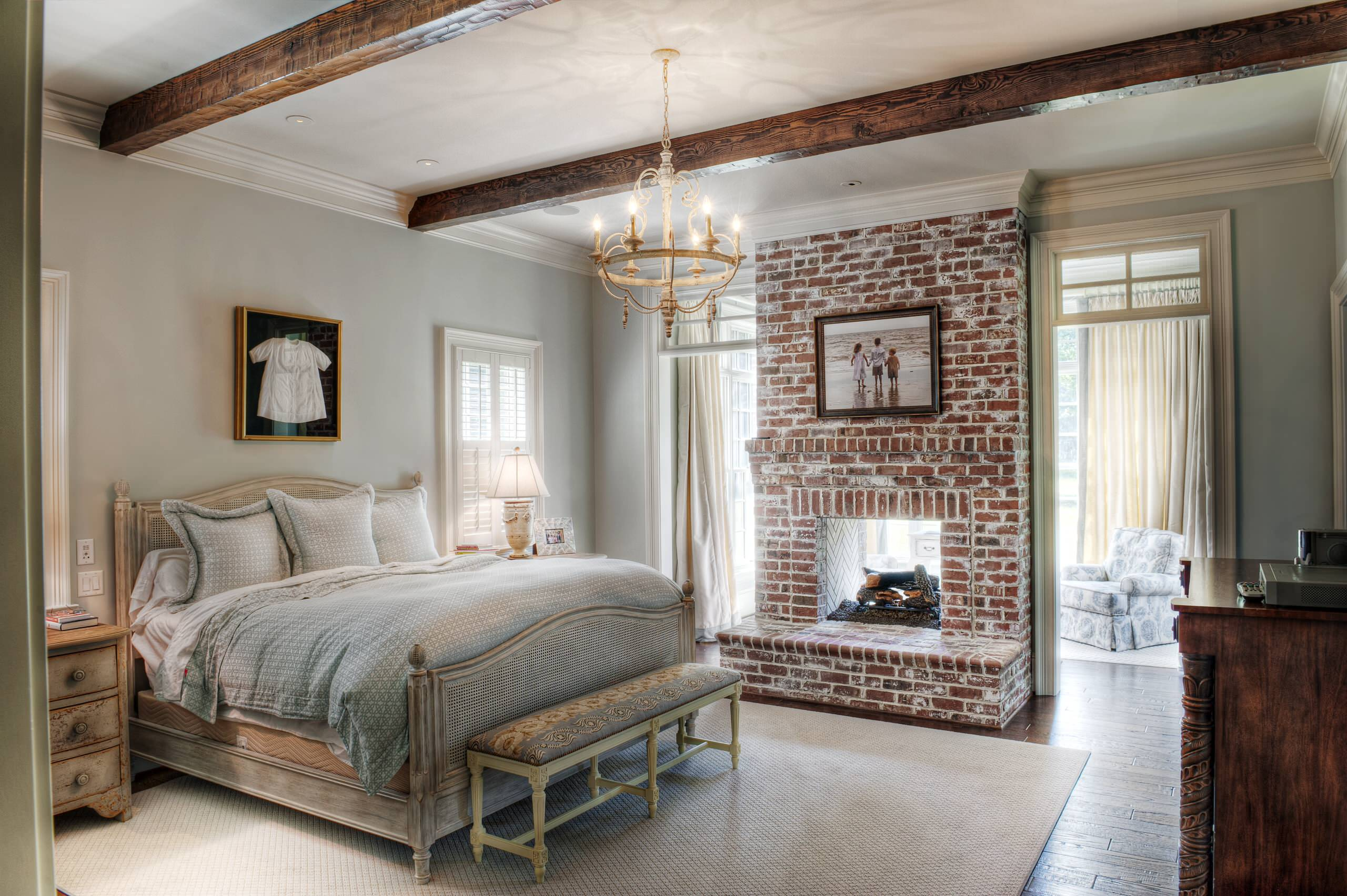 Rug Size for Queen Bed Traditional Bedroom Brick Fireplace Separate Seating Area