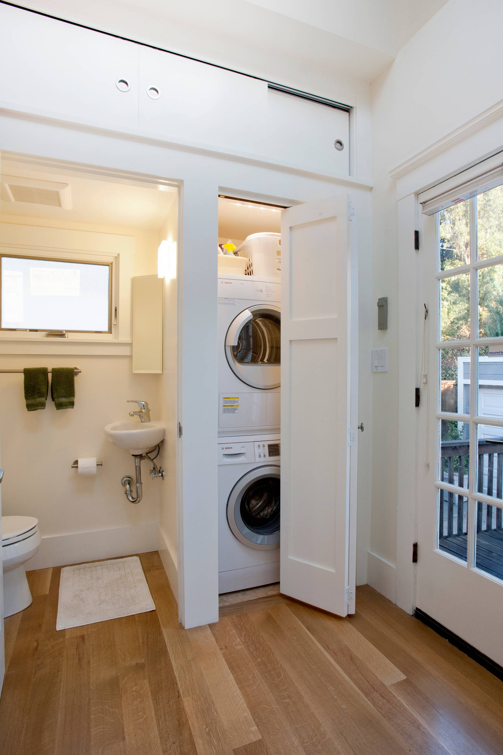 Washer and dryer in bathroom Craftsman Laundry Room white cabinets and white walls laundry room appliances