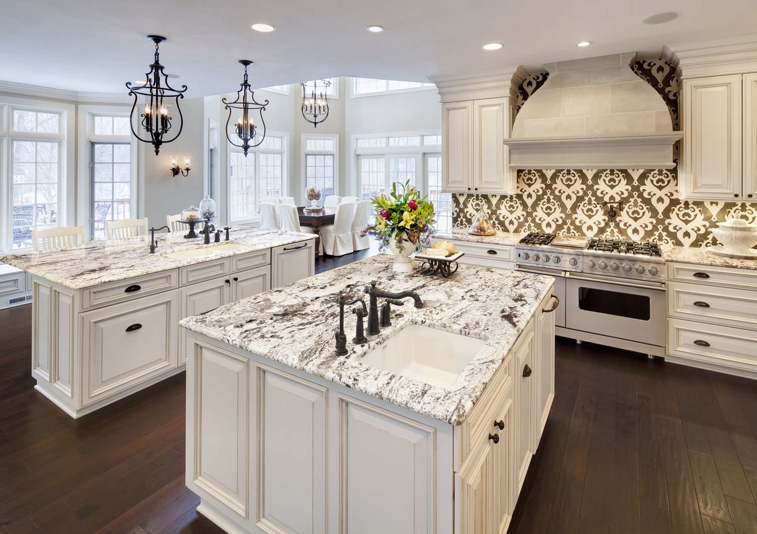 White Cabinets with Wood Floors Traditional Kitchen Accent Tiles Ceiling Lighting Breakfast Bar Granite Countertops