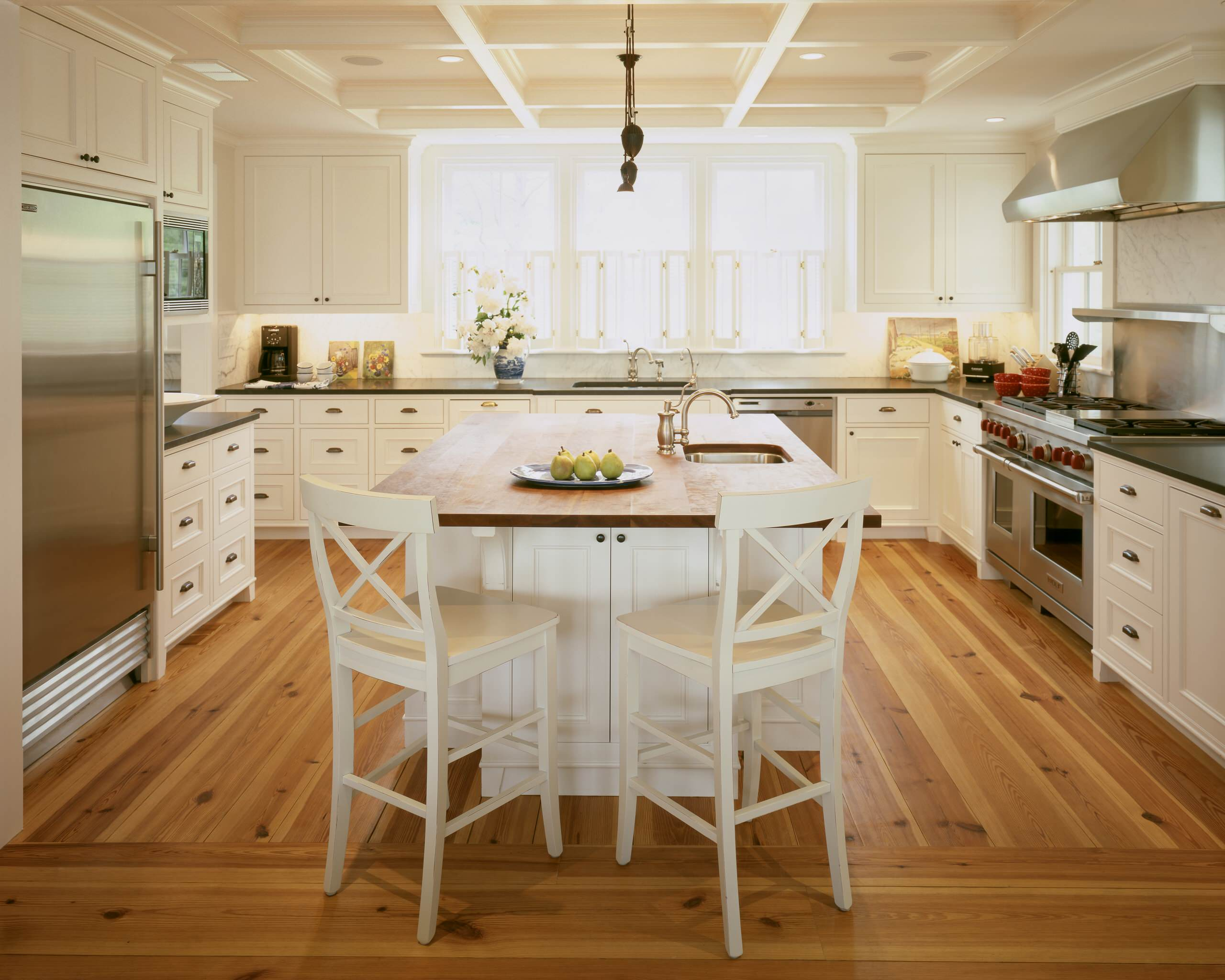 White cabinets with wood floors Traditional Kitchen coffered ceiling white barstools wood counter