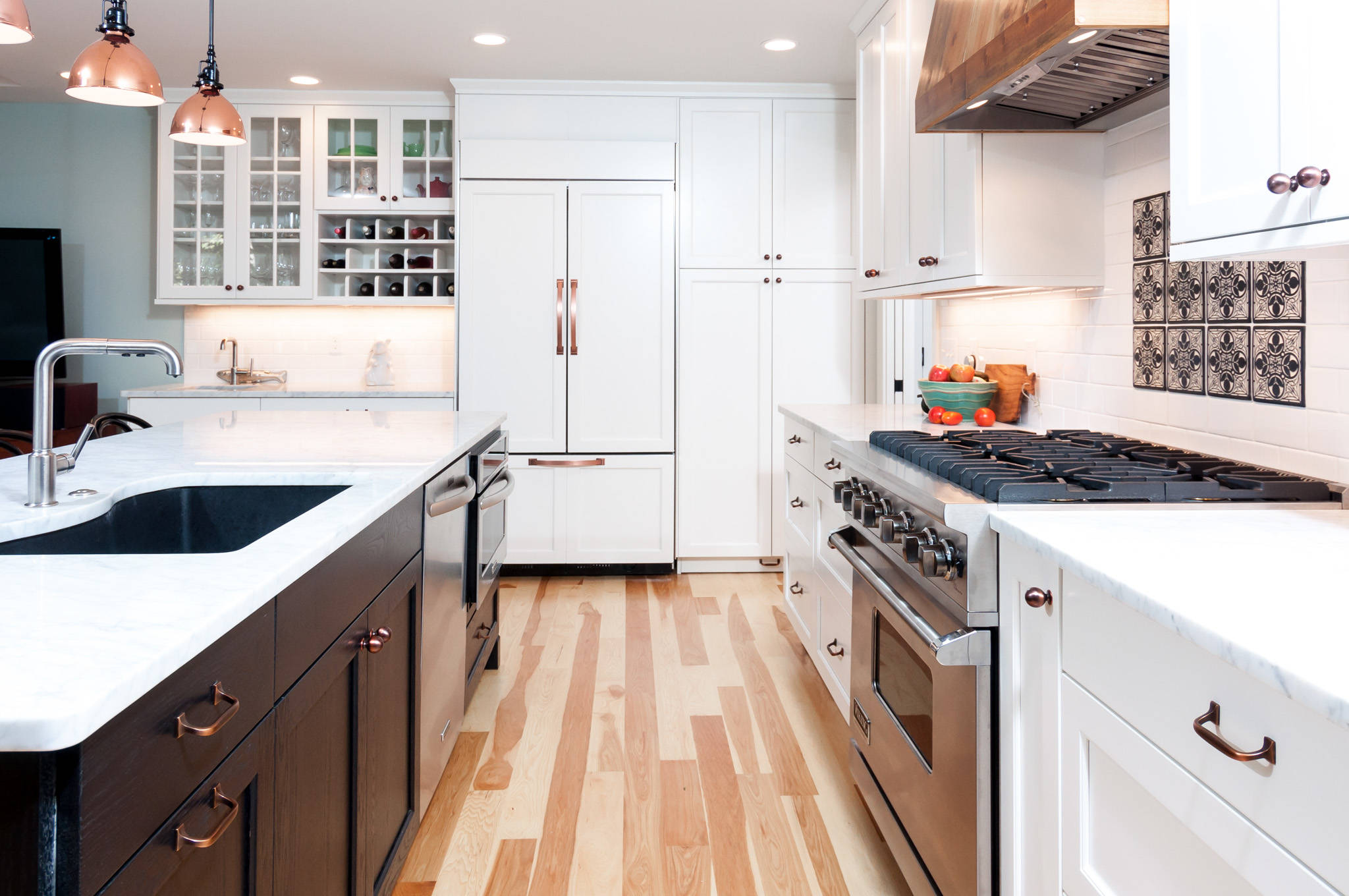 White Cabinets with Wood Floors Transitional Kitchen Copper Accents Stainless Steel Appliances White Tile Backsplash