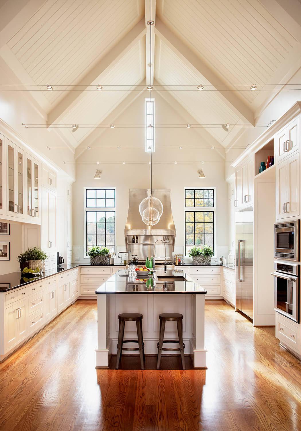 Black and White Kitchen Traditional Kitchen Wood Floors Vaulted Ceiling Wall Mounted Oven Cathedral Ceiling