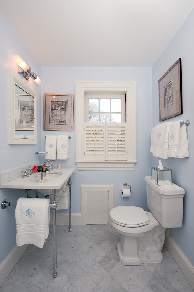 Toilet paper holder height Traditional Bathroom marble flooring wall decor window shutters console sink
