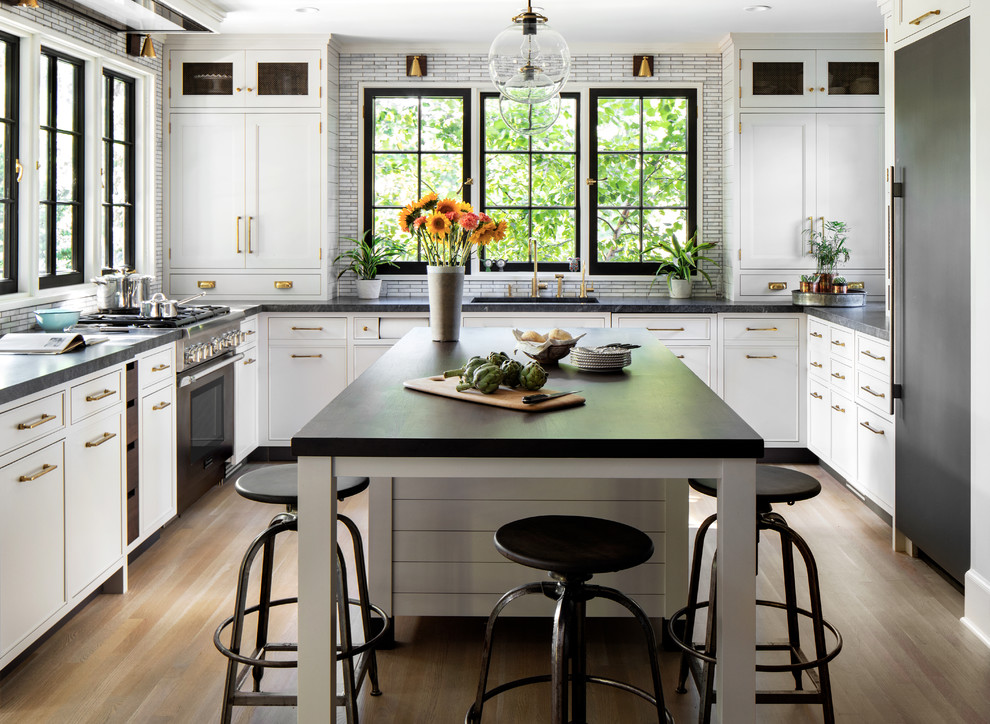 White cabinets black countertops Farmhouse Kitchen dark grout tile mosaic backsplash island seating