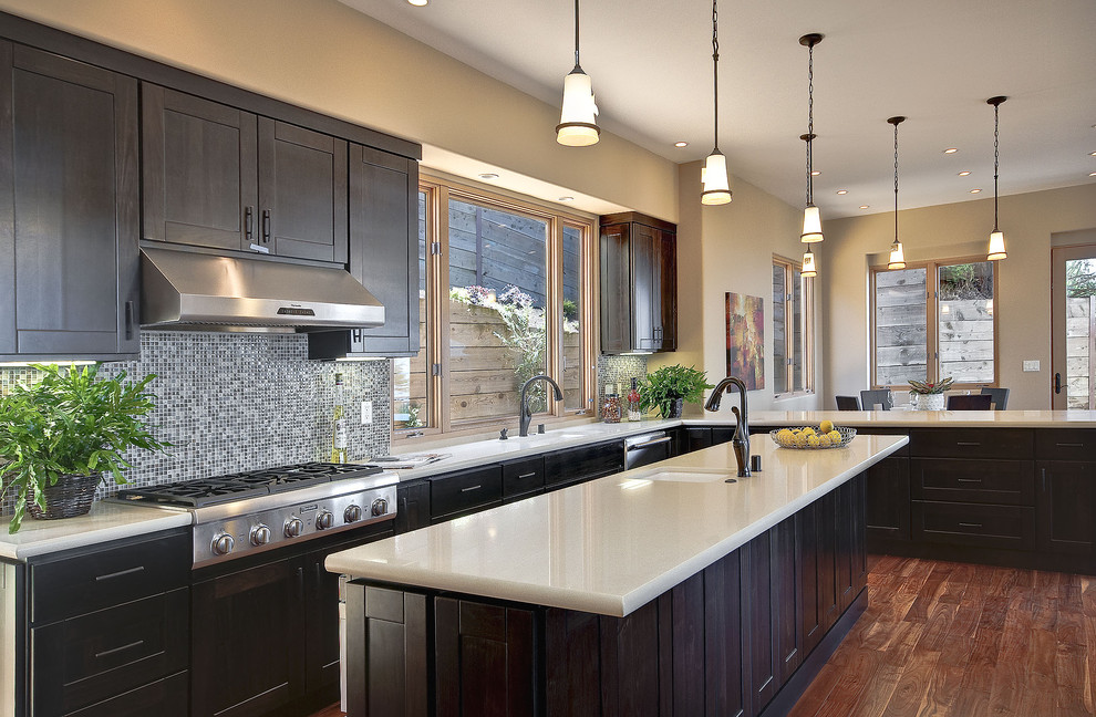 Dark cabinets light countertops Contemporary Kitchen dark stained cabinets mosaic tile backsplash wood floor