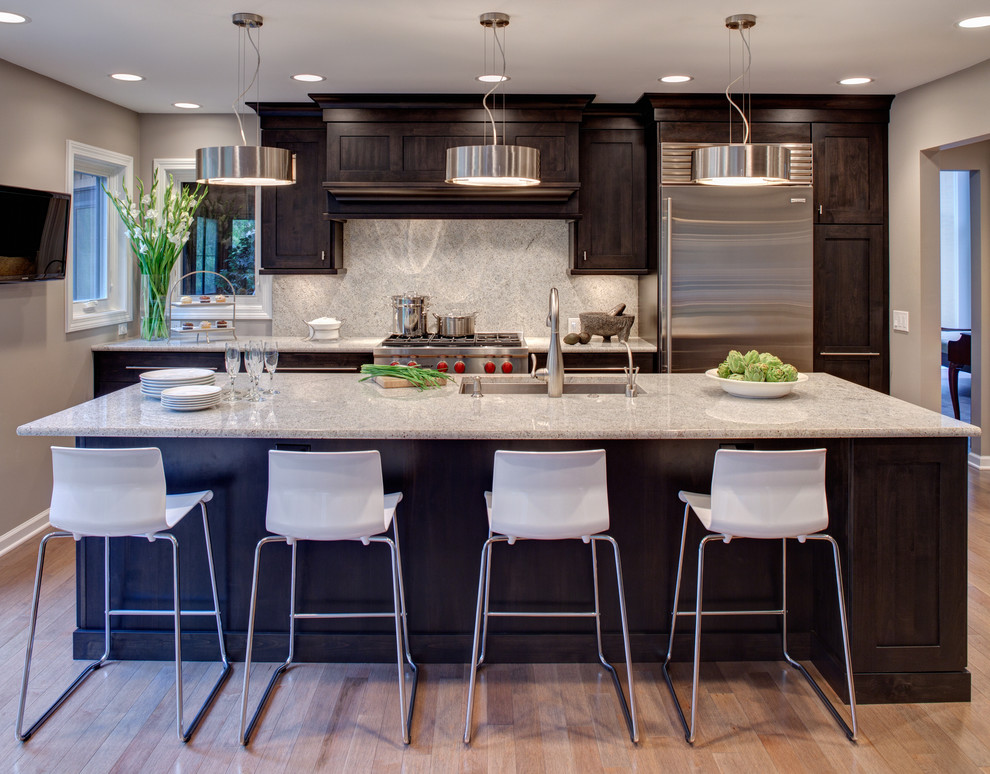 Dark Cabinets Light Countertops Contemporary Kitchen Silver Pendant Lights Stainless Steel Appliances Undermount Sink