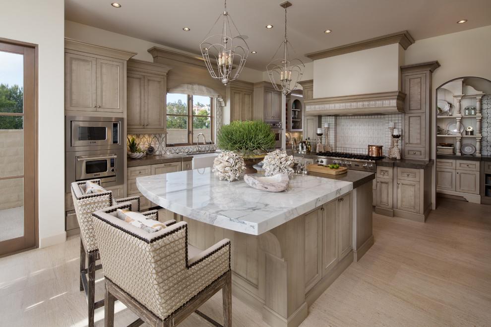 Martin luther king jr house Beach Style Kitchen calacatta island seating limestone pendant light marble countertops