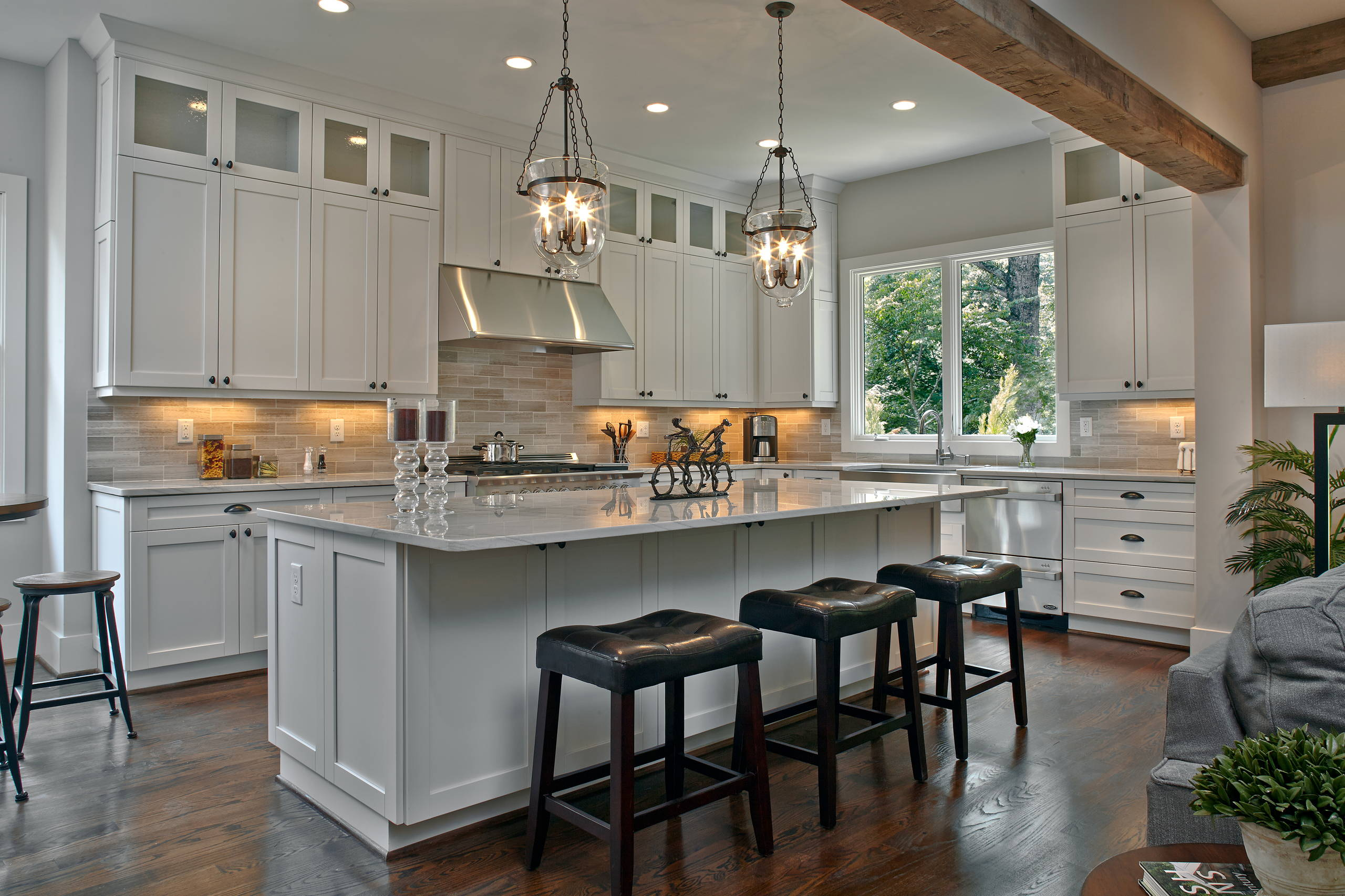 Dark Floors White Cabinets Traditional Kitchen Double Drawer Dishwasher Marble Countertops Stone Backsplash