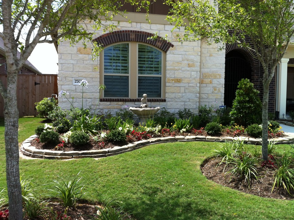 Front yard landscaping ideas with rocks Traditional Landscape bark mulch ground cover border planting