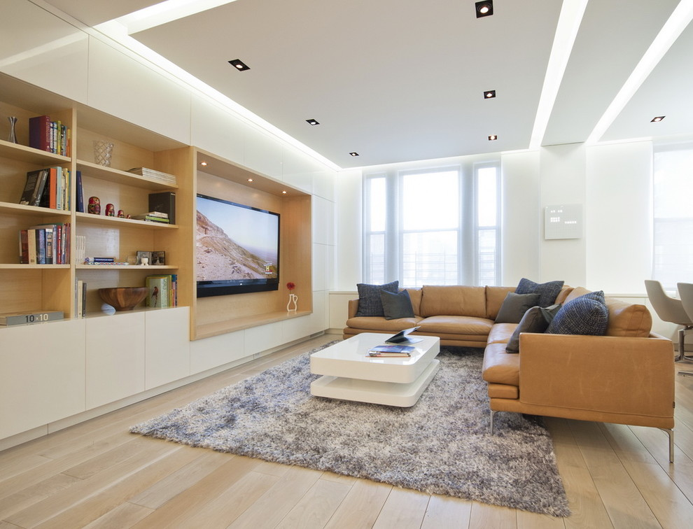 Tv wall mount height Modern Living Room area rug built-in shelves leather couch wood flooring