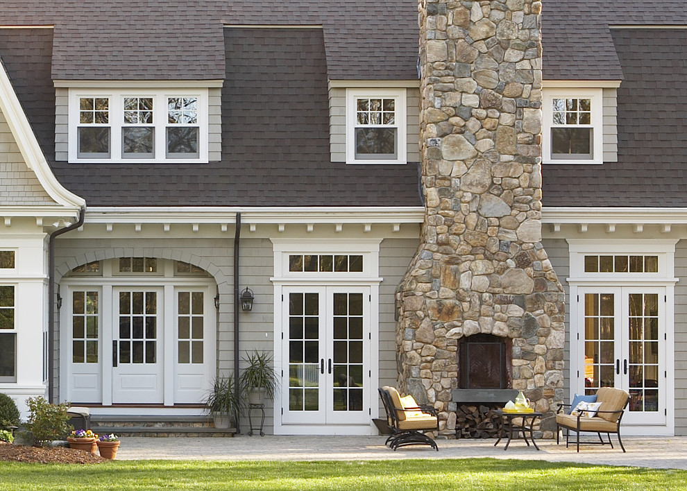 White Trim with Wood Doors Traditional Exterior Firewood Storage French Doors Outdoor Potted Plant