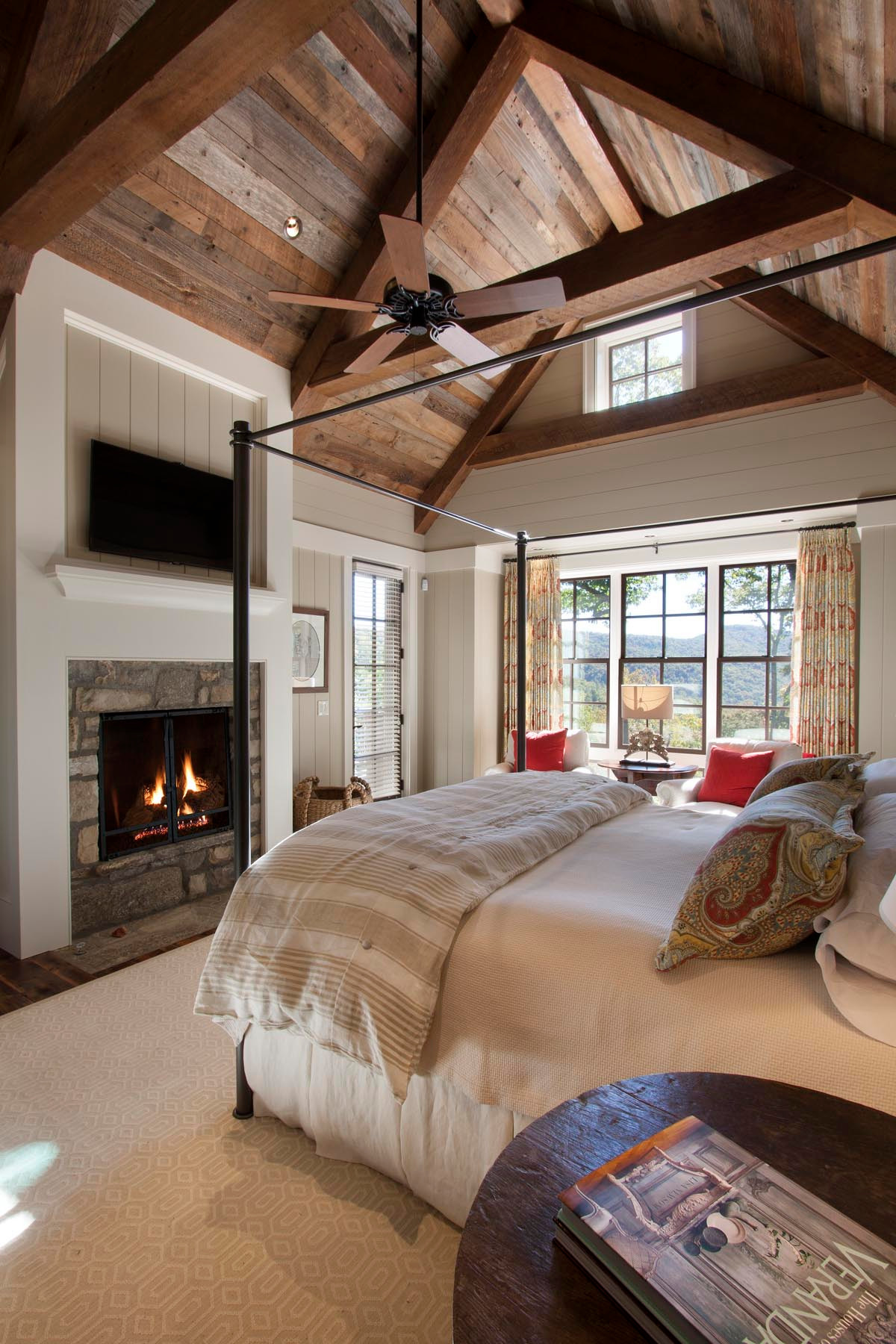Can a Duvet Cover Be Used on a Comforter? Rustic Bedroom Fireplace Beige Rug Ceiling Fan Rustic Wood Ceiling Beams