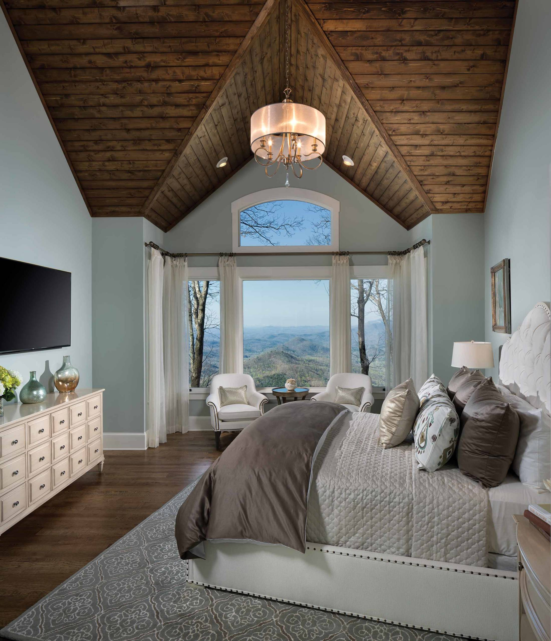 Can a Duvet Cover Be Used on a Comforter? Traditional Bedroom Arched Window Casual Elegance Ceiling Design Chandelier Hardwood Floors Master Bedroom