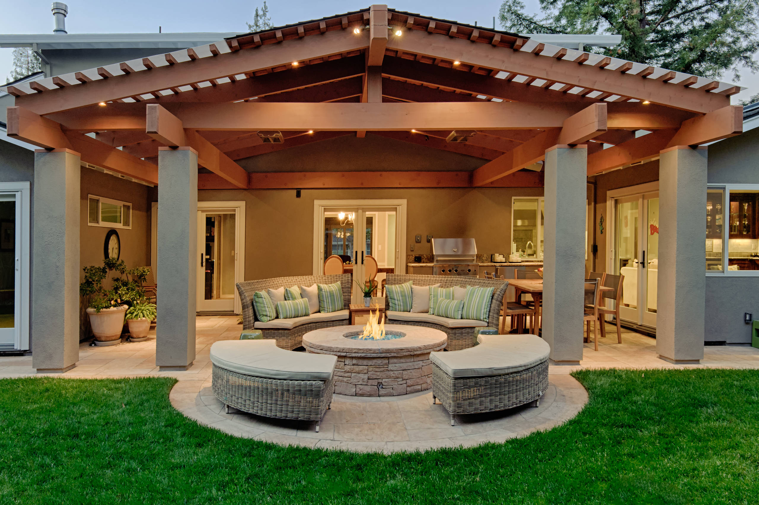 Post and beam construction Traditional Patio Covered Patio exposed beams gable roof cobblestone firepit outdoor cushions
