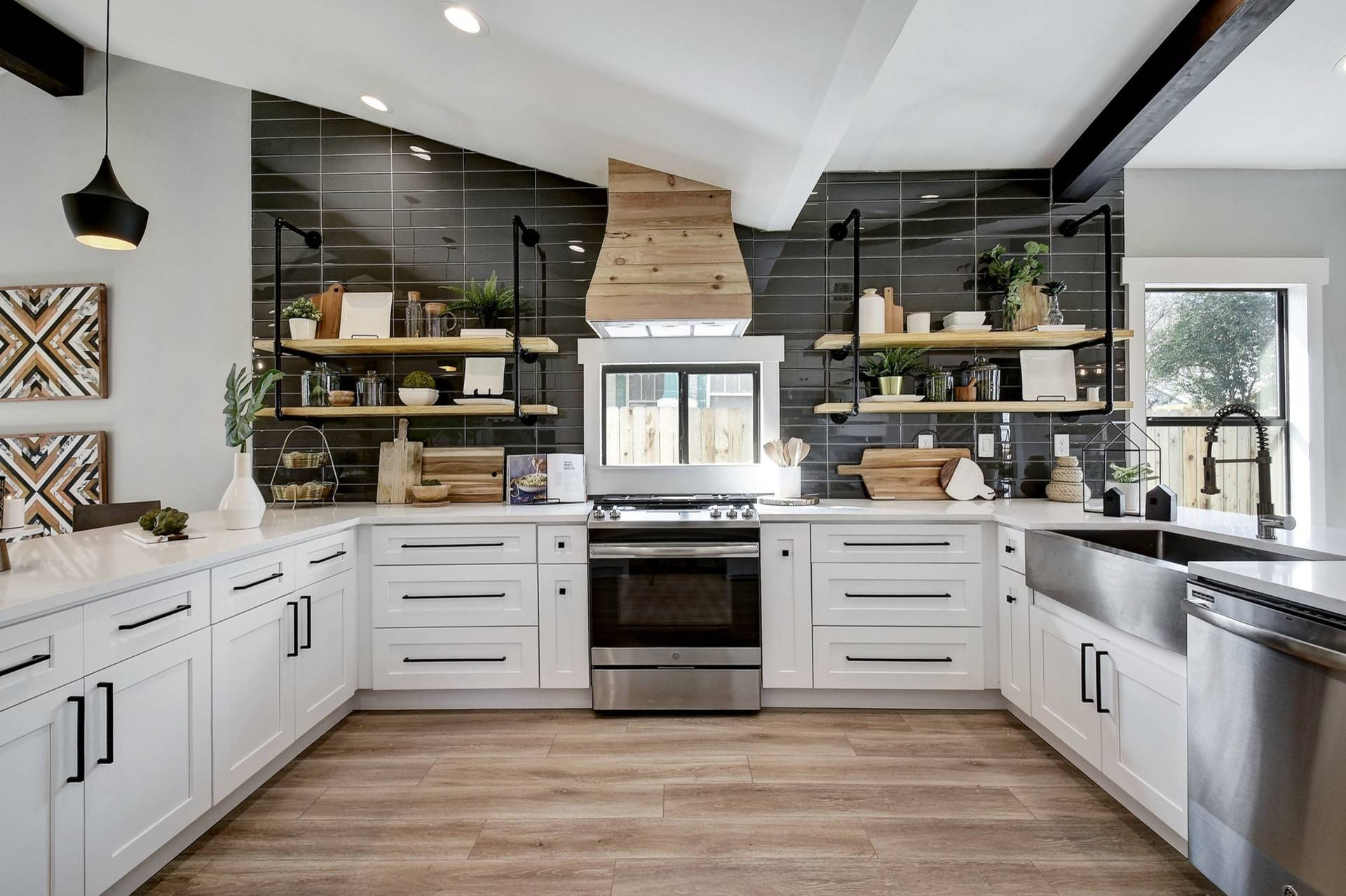 White Cabinets Black Appliances Contemporary Kitchen Bronze Pulls Carrara Marble Island Carrara Marble Slab Backsplash Floating Shelves Open Floor Plan