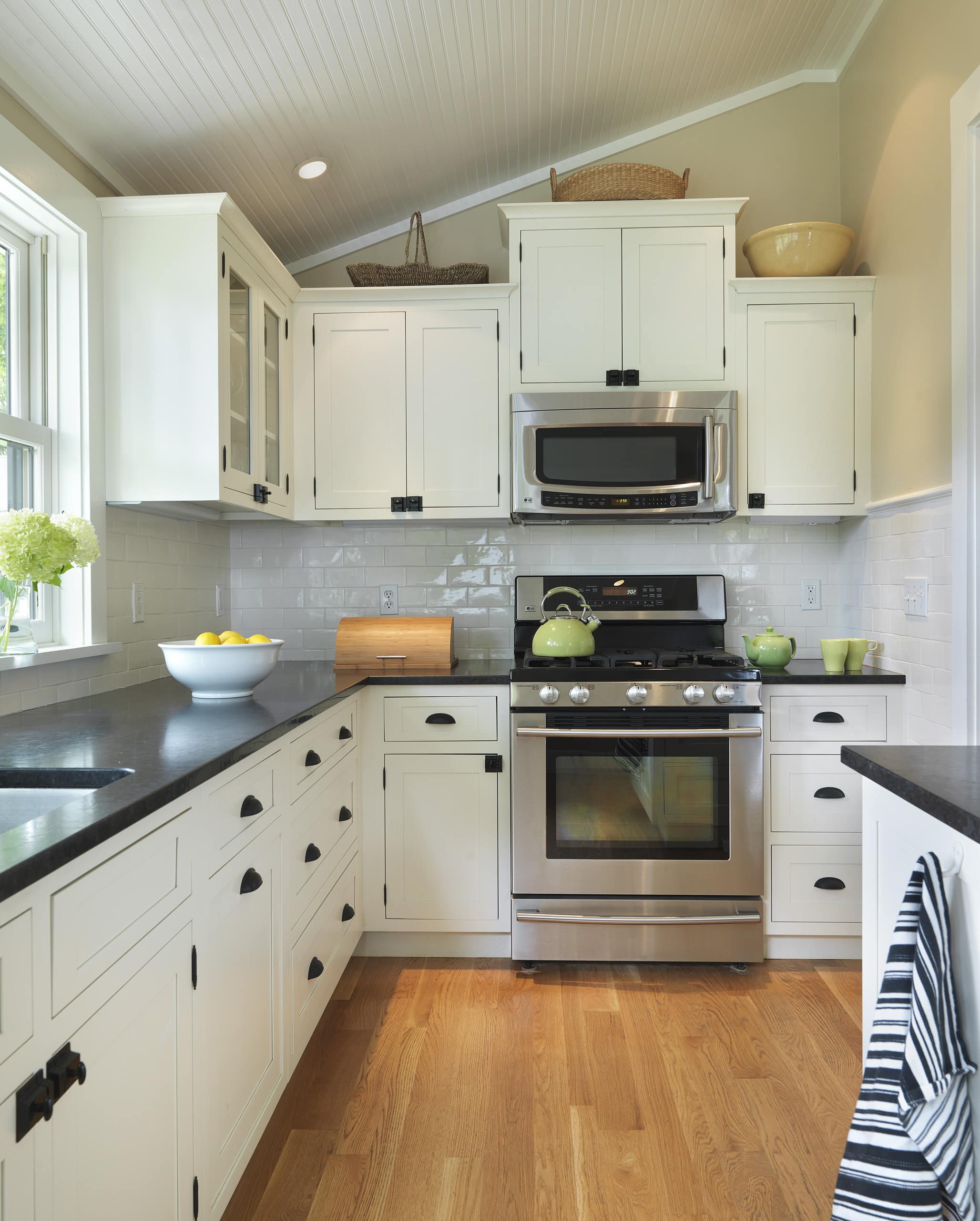 White Cabinets Black Appliances Traditional Kitchen Breakfast Bar Ceiling Lighting Dark Floor