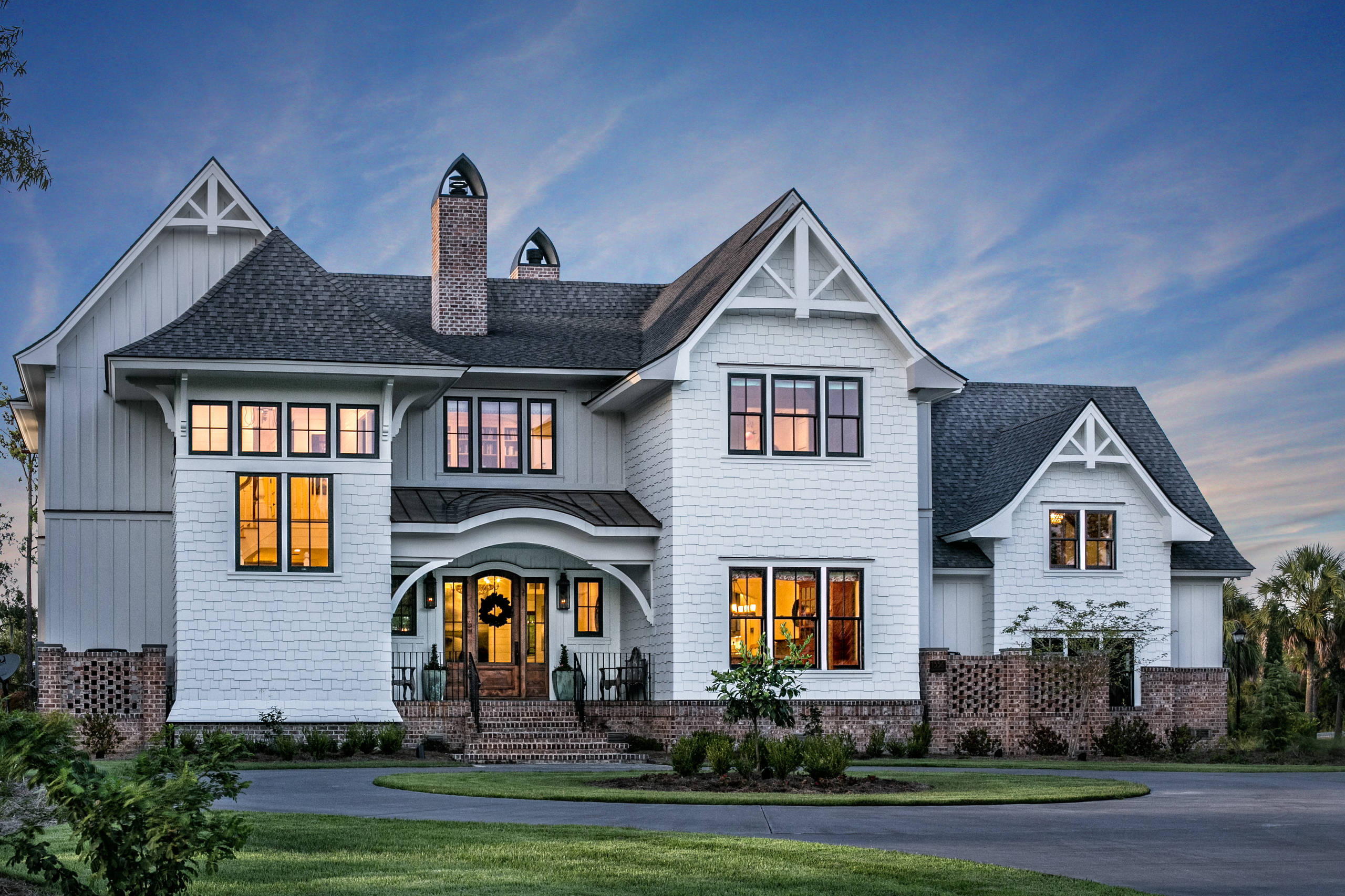 White house black windows Traditional Exterior brick base house white shingle siding