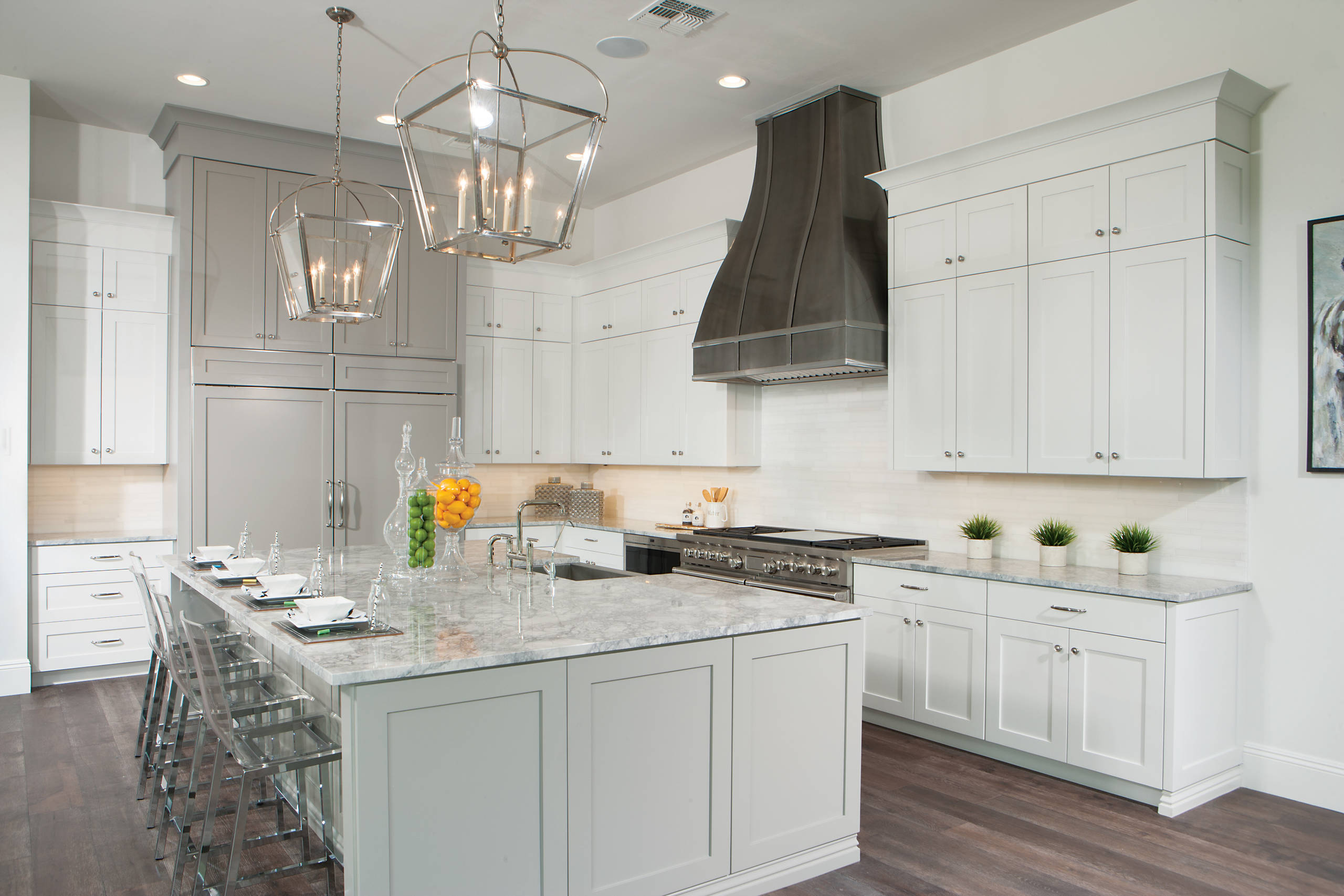 White Kitchen Dark Floors Transitional Kitchen Apothecary Jars Casual Elegance Classic Kitchen Clear Counter Stools L Shaped Kitchen Lanterns Over Island