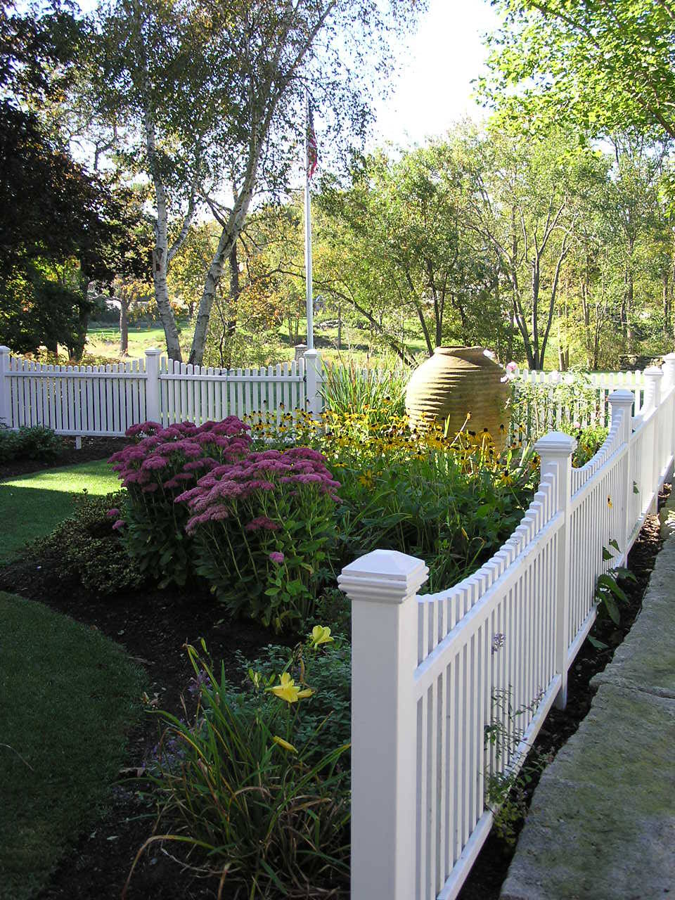 White picket fence house Traditional Landscape arbor climbing plants cottage entrance entry grass lawn