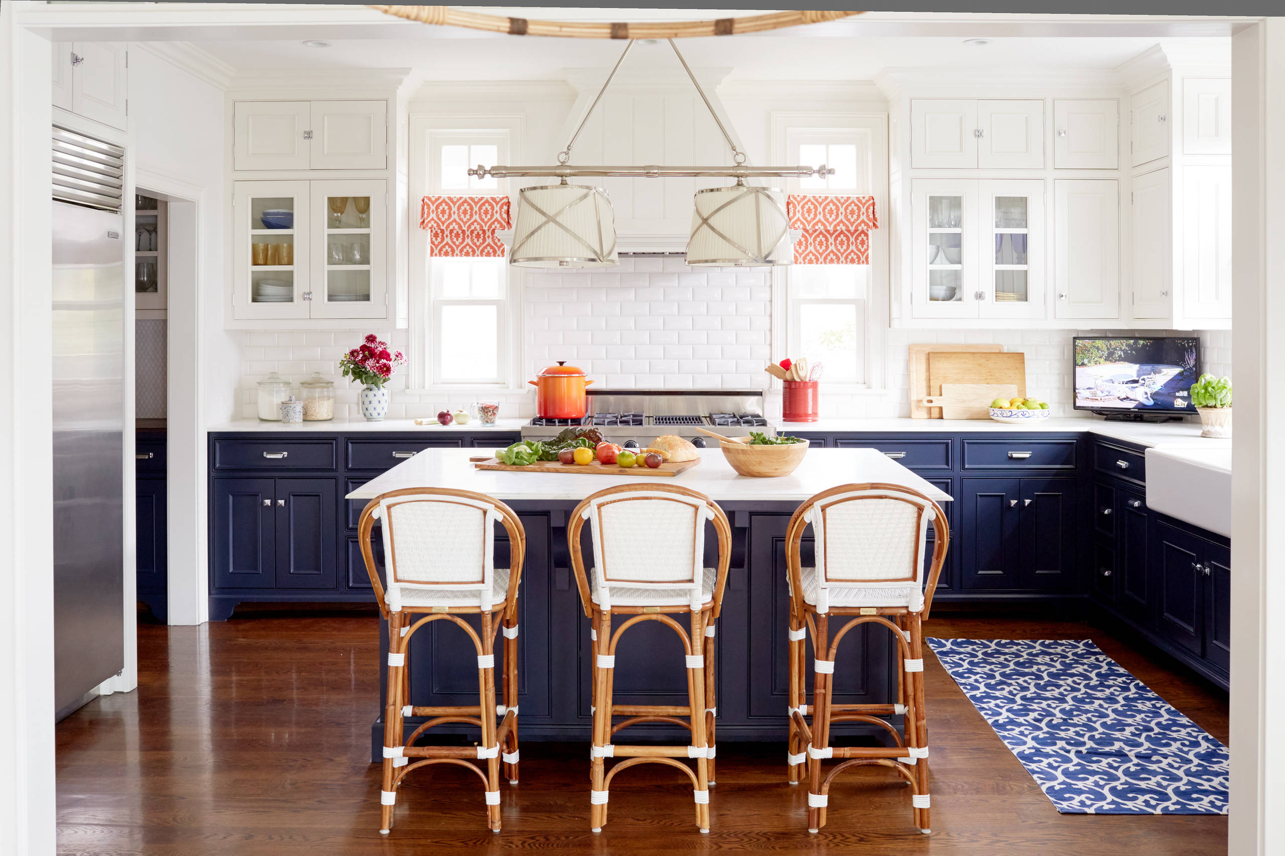 Blue and white kitchen Beach Style Kitchen beach home blue and red casual elegance counter stools lanterns
