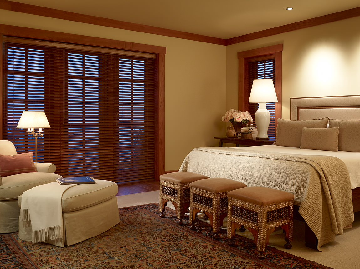How to clean wooden blinds in Traditional Bedroom area rug bamboo blinds bedside table dark floor earth tone colors