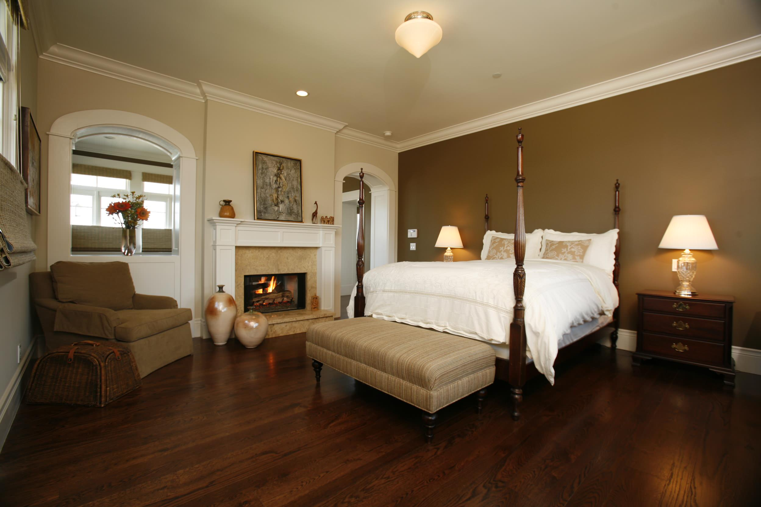 What colors look good with brown in Traditional Bedroom beadboard beige wall crown molding fireplace mantel iron bed pained windows